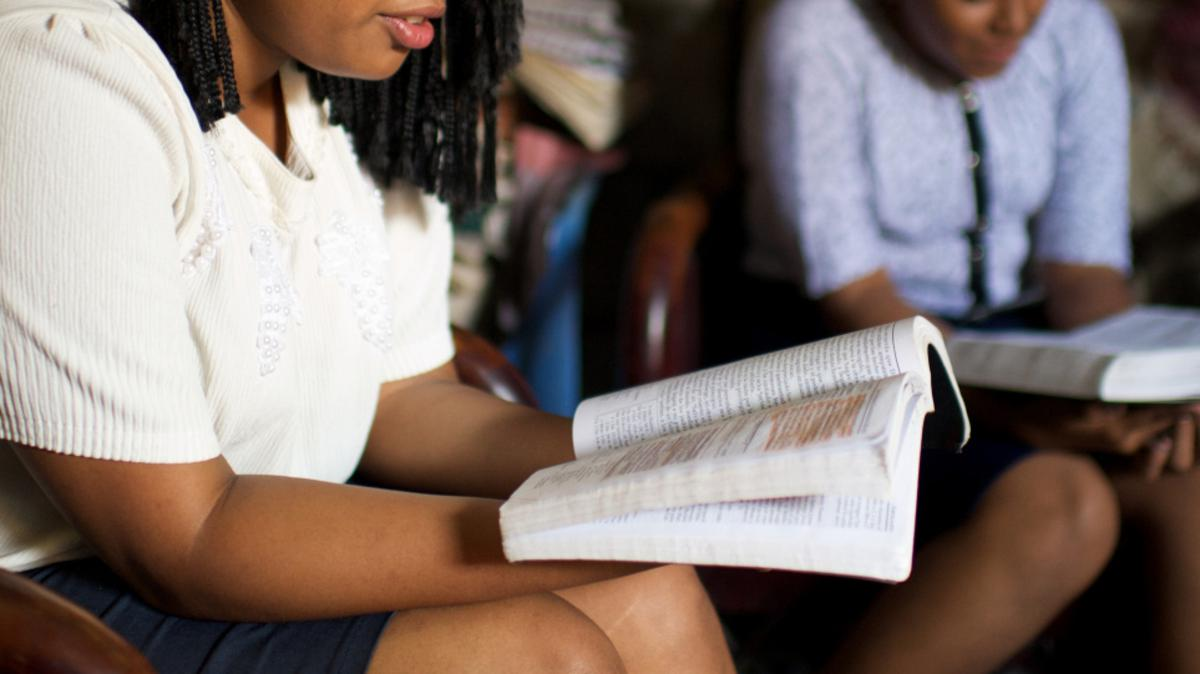 YOUNG WOMEN STUDYING SCRIPTURES